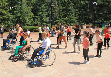 Kicking off CIL's awareness campaign, participants with and without disabilities dance in a flash mob.