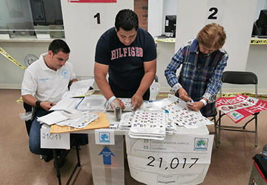 Poll workers set up Election Day materials at the Los Angeles polling center. © TSE