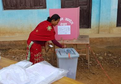 A voter casts a ballot in Nuwakot during the 2017 general elections.
