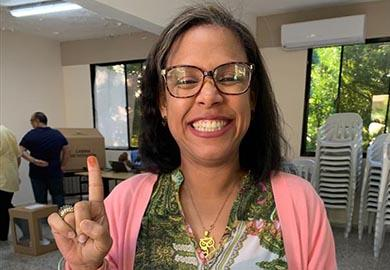 A Dominican voter displays her inked finger during the February 2020 municipal elections.