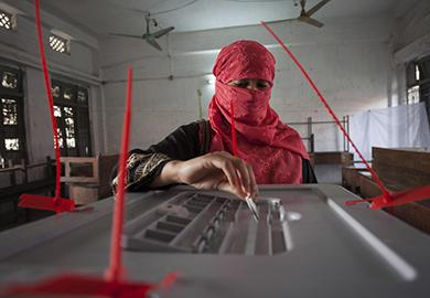 A Bangladeshi woman votes in the 2014 national elections.