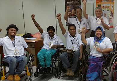 Observers with disabilities in Malaysia pose together at the end of their training. Source: AGENDA