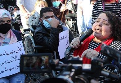 Sylvana Lakkis of IFES' partner, the Lebanese Union for People with Physical Disabilities, speaks out during a march demanding human rights following the August 2020 explosion in Beirut.