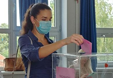 A Serbian voter casts her ballot on Election Day.