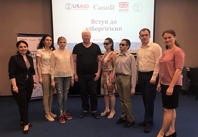 Participants with visual disabilities and their peers at IFES' cyber-hygiene training in Kyiv, Ukraine