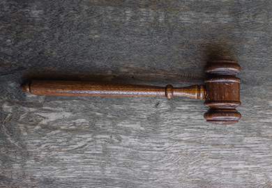 Gavel on a wooden surface