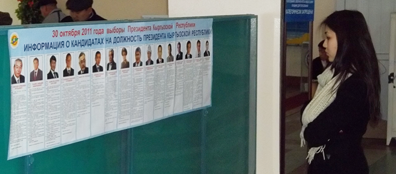 A voter examines the candidate list during Kyrgyzstan's 2011 elections.