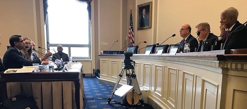 Mohan testifying before the House of Representatives' Tom Lantos Human Rights Commission