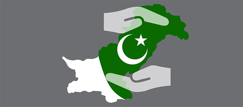 Two hands encircle a map of Pakistan