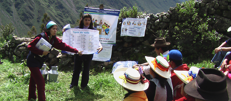 Representatives from Peru's National Office of Electoral Processes conduct voter education in a remote area in 2006.