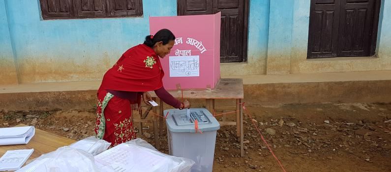 A voter casts a ballot in Nuwakot during the 2017 general elections