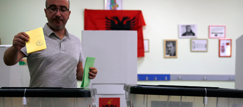 An Albanian man casts his ballot at a polling station in Tirana during the 2019 municipal elections.