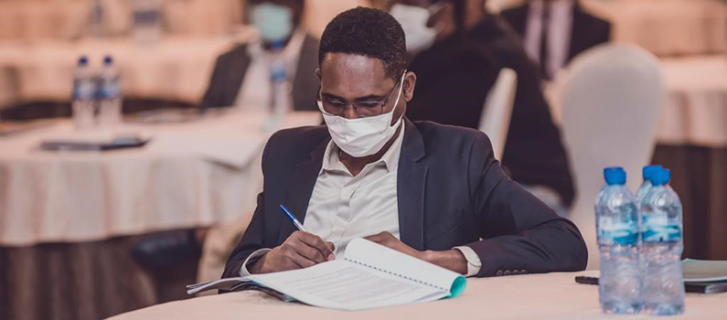 A participant takes notes during an election dispute resolution training in Ethiopia.