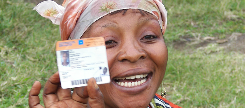 A women in the Democratic Republic of Congo holds up their voter ID.