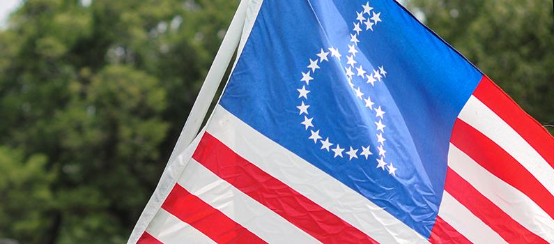 U.S. flag in which the stars are in the shape of a person using a wheelchair