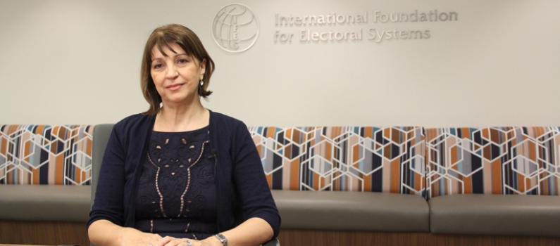 IFES Board Director, Irena Hadžiabdić sits at a desk