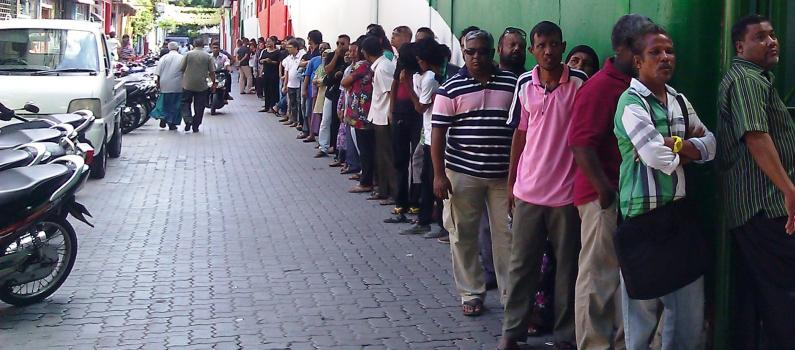 Maldivians line up to vote at a Malé polling station