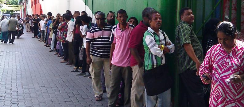 Maldivians line up to vote at a Malé polling station.