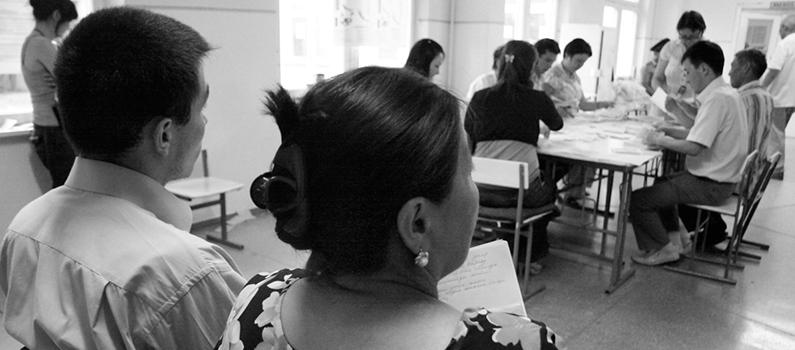 Observers watch the ballots being counted during the 2010 constitutional referendum in Kyrgyzstan.