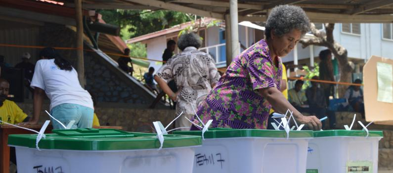 A woman votes in the Moitu-Koita local-level government elections in August 2018.