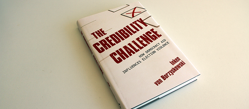 "Copy of ""The Credibility Challenge: How Democracy Aid Influences Election Violence"""