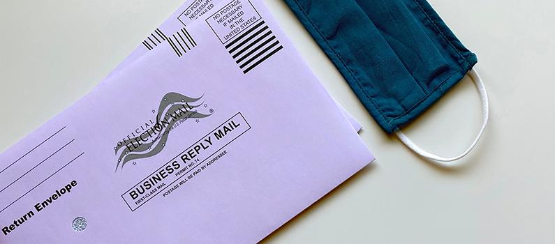 Envelopes for returning U.S. ballots and a fabric face mask