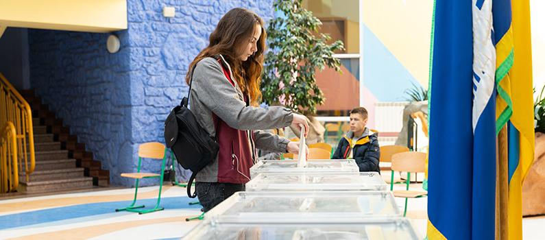 A woman votes in the 2019 presidential election at a polling station in Kyiv.