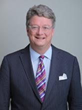 Headshot of board member Ambassador Tom McDonald.