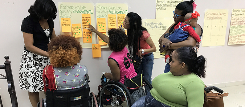 Young women with disabilities take part in a focus group discussion in February 2018.