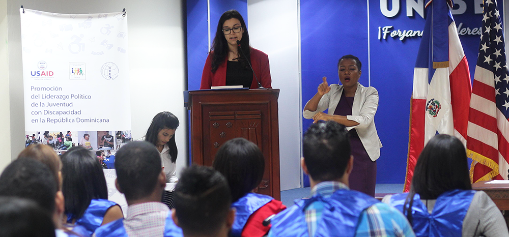 Buril speaks to Dominican youth with disabilities who completed an IFES course on leadership and political processes during their graduation ceremony.