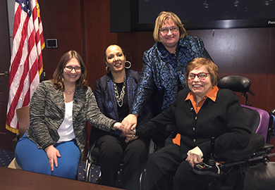IFES Inclusion Advisor Virginia Atkinson and panelists Charlotte McClain-Nhlapo, Isabel Hodge and Judith Heumann pose together.